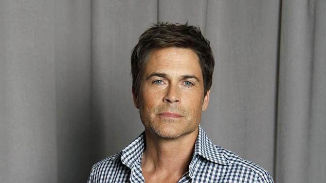 """FILE - This April 25, 2012 file photo shows actor Rob Lowe posing for a portrait in New York. Lowe will narrate """"The '80s: The Decade That Made Us,"""" a six-part documentary series that begins airing Sunday on National Geographic Channel.  (AP Photo/Amy Sussman, file)"""