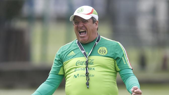 Mexico's coach Herrera gestures during a practice session in Mexico City