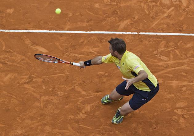 Stanislas Wawrinka of Switzerland returns the ball to David Ferrer of Spain during their semifinal match of the Monte Carlo Tennis Masters tournament in Monaco, Saturday, April 19, 2014. Wawrinka won