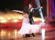 "In this Nov. 21, 2011 photo released by ABC, Rob Kardashian, right, and his partner Cheryl Burke perform on the celebrity dance competition series ""Dancing with the Stars,"" in Los Angeles. On Tuesday, the remaining three couples will perform their favorite dance of the season for another score from the judges before the third-place finalists are eliminated. The remaining two pairs will compete in one final routine for the season 13 title. (AP Photo/ABC, Adam Taylor)"