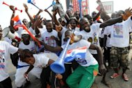 Supporters of Nana Akufo-Addo dance in Kasoa, central Ghana, on Saturday. The opposition presidential candidate has sparked debate with a proposal to abolish fees at senior high schools which can amount to several hundred dollars per term and can keep education out of reach for many families