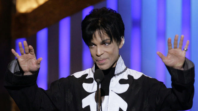 "FILE - In this March 2, 2007 file photo, Prince accepts an award during the NAACP Image Awards in Los Angeles. He is scheduled to appear on ""Late Night with Jimmy Fallon."" A rep for the late-night talk show confirmed the pop legend will appear on the show Friday, March 1, 2013, and perform two songs. (AP Photo/Chris Carlson, file)"