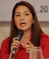 Gwendolyn Pang, secretary-general of the Philippine Red Cross, gives a press briefing in Manila on May 5, 2014, as she warns reporters of the difficulties still facing the tens of thousands of survivors of Super Typhoon Haiyan