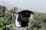 "The burnt building of the ""Sagrado Corazon de Jesus"" rehabilitation centre for drug and alcohol addicts, in Chosica district, in Lima is pictured. Fire swept through the drug rehabilitation center early Saturday, killing 14 people who were unable to escape the inferno because windows were barred and doors were locked, firefighters said"