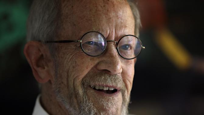 FILE - In this Sept. 17, 2012, file photo is author Elmore Leonard at his Bloomfield Township, Mich., home. The acclaimed crime novelist recovering at a hospital following a stroke last week. Leonard's longtime researcher, Gregg Sutter, said Tuesday, Aug. 6, 2013, that family members are guardedly optimistic about the 87-year-old condition. (AP Photo/Paul Sancya, File)