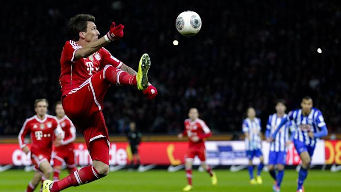Bayern's Mario Mandzukic of Croatia plays the ball during the first division Bundesliga soccer match between Hertha BSC and FC Bayern Munich in Berlin, Tuesday, March 25, 2014