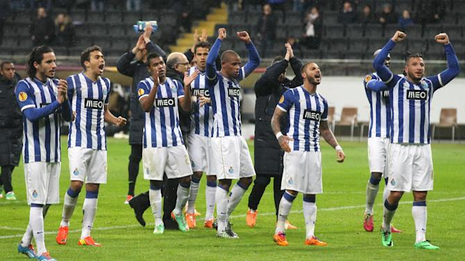 Porto's players celebrate after a Europa League round of 32 second leg soccer match between Eintracht Frankfurt and FC Porto in Frankfurt, Germany, Thursday, Feb. 27, 2014
