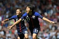 Japan's Kensuke Nagai (R) celebrates scoring during the London 2012 Olympic men's football quarter final match between Japan and Egypt at Old Trafford in Manchester, north-west England. Japan won 3-0