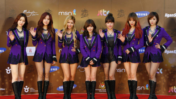 South Korean girl group T-ara pose for photographers as they arrive on the red carpet ahead of the 27th Golden Disk Awards at Sepang International Circuit in Sepang, Malaysia, Wednesday, Jan. 16, 2013. (AP Photo/Lai Seng Sin)