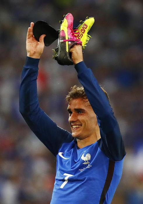 France's Antoine Griezmann celebrates at the end of the match