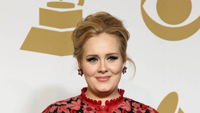 "Adele poses backstage with the award for best pop solo performance for ""Set Fire to the Rain"" at the 55th annual Grammy Awards on Sunday, Feb. 10, 2013, in Los Angeles. (Photo by Matt Sayles/Invision/AP)"