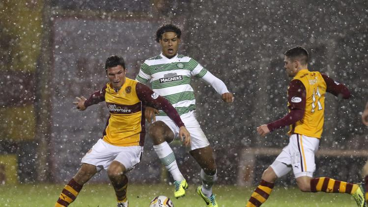 Celtic's Van Dijk challenges Motherwell's Sutton and Vigurs during their Scottish Premier League match in Motherwell