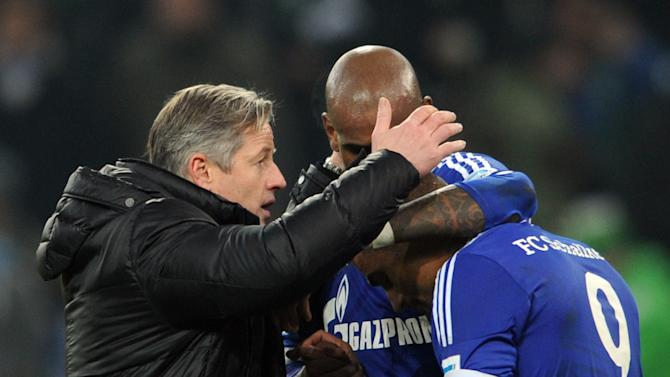 Schalke's head coach Jens Keller thanks his players Felipe Santana, center,  and Kevin-Prince Boateng, right,  after the Bundesliga soccer match between Borussia Moenchengladbach and FC Schalke 04 at Borussia Park in Moenchengladbach, Germany Saturday Dec. 7, 2013