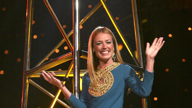 """Cat Deeley was perhaps inspired by Cleopatra when she announced """"So You Think You Can Dance"""" Season 5's Top 10 because her retro outfit consisted of a vintage dress, gigantic Melinda Maria earrings, and golden Sergio Rossi heels."""