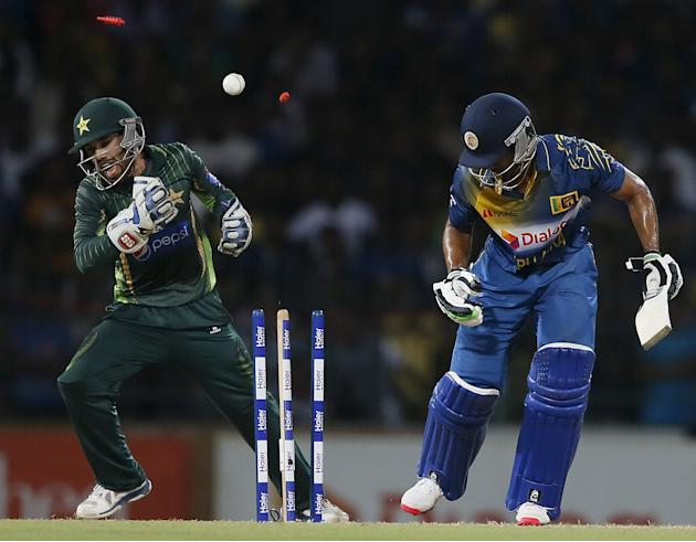 Sri Lanka's de Silva is bowled out by Pakistan's captain Afridi next to Pakistan's wicket Rizwan during their second Twenty 20 cricket match in Colombo