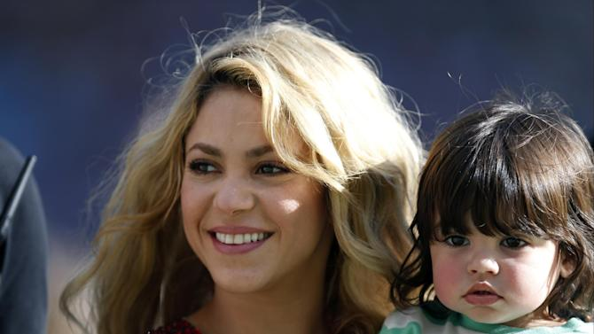 Singer Shakira carries her son Milan after she performed during the closing ceremony prior to the World Cup final soccer match between Germany and Argentina at the Maracana Stadium in Rio de Janeiro, Brazil, Sunday, July 13, 2014
