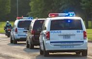 """A police convoy carrying porn actor Luka Rocco Magnotta, dubbed """"the Canadian Psycho"""", departs Mirabel Airport outside Montreal on June 18, 2012 in Mirabel, Quebec, Canada. Magnotta is accused of slaying and dismembering a Chinese student in Montreal last month, before fleeing to Europe"""