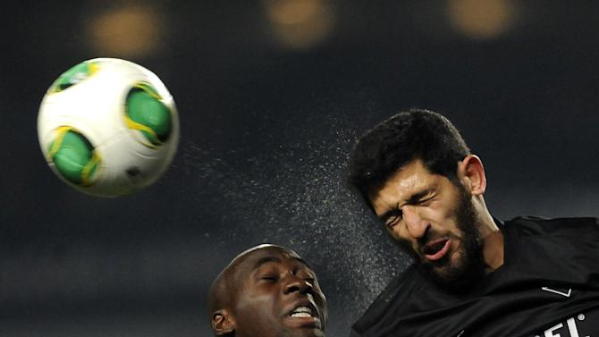 FC Porto's Eliaquim Mangala, left, from France challenges for a high ball withAcademica's Rafik Halliche, from Algeria, in a Portuguese League soccer match at the Municipal Stadium in Coimbra, Portugal, Saturday, Nov. 30, 2013