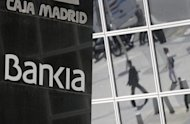Bankia and other bailed-out Spanish lenders may receive their European rescue funds sooner than the September date previously planned