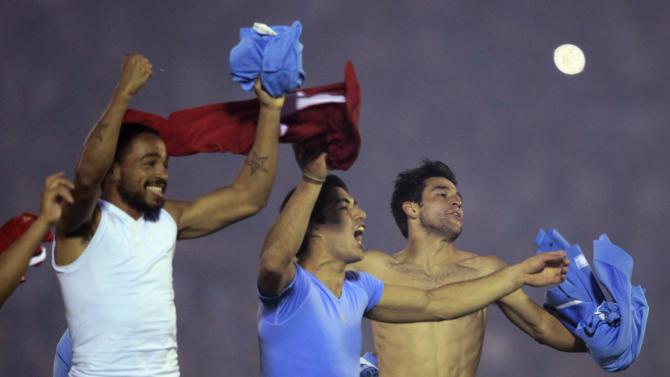 Pereira, Suarez and Lodiero of Uruguay celebrate at the end of their 2014 WC qualifying playoff second leg soccer match against Jordan in Montevideo