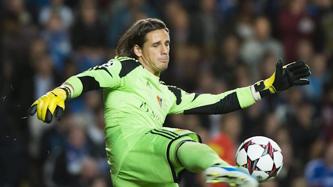 In this Sept. 18, 2013 file picture Basel's goalkeeper Yann Sommer,  defends during the UEFA Champions League first round group E soccer match between Britain's Chelsea FC and Switzerland's FC Basel in London,  Switzerland and Basel goalkeeper Yann Sommer will join Borussia Moenchengladbach at the end of the season. Basel says  Monday March 10, 2014 the 25-year-old player has agreed a five-year contract with the Bundesliga club. The transfer fee was not disclosed. Moenchengladbach's current 'keeper, Marc-Andre ter Stegen has been linked with a move to Barcelona