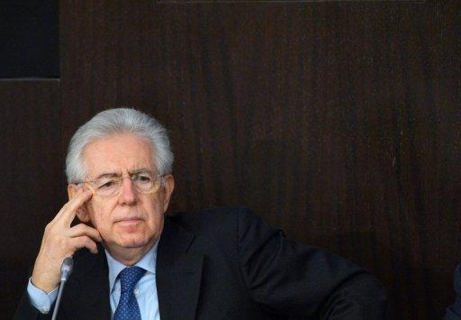 An offer by Mario Monti, pictured here at a press conference in Rome on December 23, 2012, to stay on as prime minister is motivated by a wish to prevent the scandal-tainted Silvio Berlusconi from returning to power and undoing key reforms, analysts said Monday.