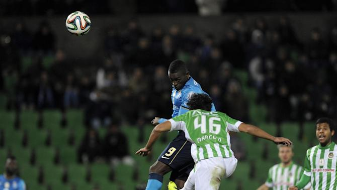 FC Porto's Jackson Martinez, left, from Colombia jumps higher to score his team second goal past Rio Ave's Marcelo Fernandes, from Brazil, in a Portuguese League soccer match, in Vila do Conde, northern Portugal, Sunday, Dec. 15, 2013