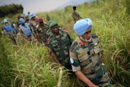 Brigadier-General Harinder Singh, the United Nations brigade commander for North Kivu, is followed by General Lucien Bahuma (C), the new commander of the Armed Forces of the Democratic Republic of the Congo (FARDC) for North Kivu, following a strategy meeting above the village of Kibumba I, around 20km from the city of Goma in the Democratic Republic of the Congo