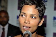 Oscar-winning actress Halle Berry, pictured in 2011, was taken to hospital after suffering a minor head injury while shooting a fight scene in her latest film, her spokeswoman said Wednesday