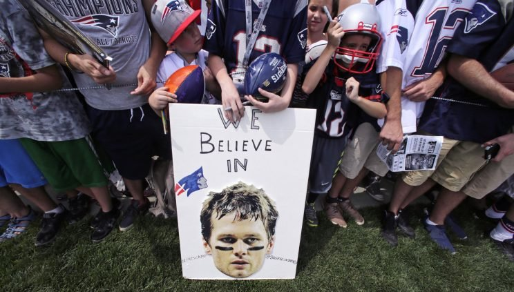 New England Patriots fans show their support for Tom Brady. (AP)