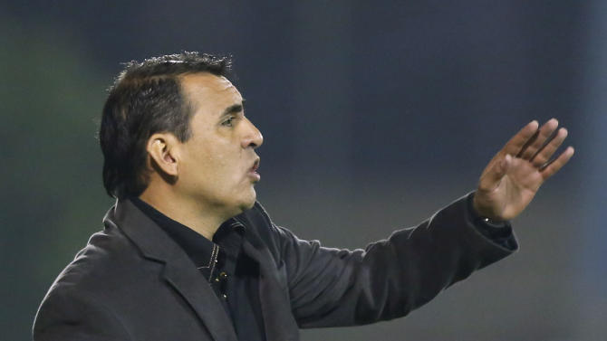 Pedro Sarabia, coach of Paraguay's Libertad, speaks from the sidelines of a Copa Sudamericana soccer game with Brazil's Sport Recife in Asuncion, Paraguay, Wednesday, Sept. 25, 2013