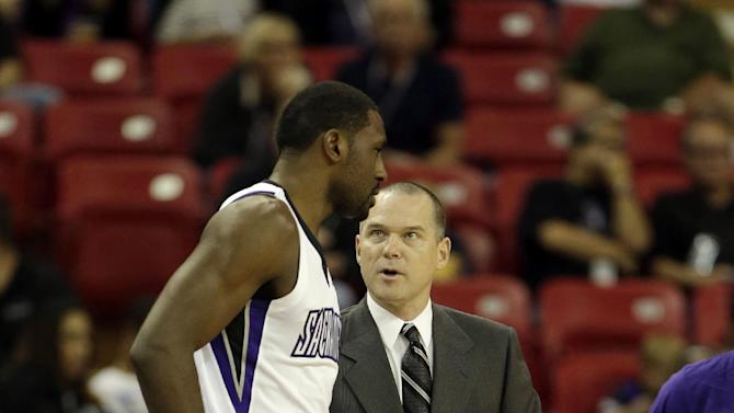 Sacramento Kings head coach Michael Malone talks with Kings forward Patrick Patterson during the first quarter against the Los Angeles Clippers in a NBA preseason basketball game in Sacramento, Calif., Monday, Oct. 14, 2013. The Kings won 99-88