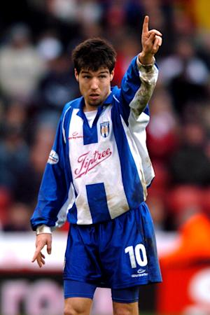 Kem Izzet is considering becoming a coach when he retires from football