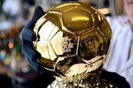 French artisan Michel Garault assembles the FIFA Ballon d'Or 2012 ('Golden Ball') at the Mellerio jewelery workshops in Paris on December 6, 2012. The displays at Mellerio jewellers in Paris teem with diamonds and sapphires. But to football fans they pale in comparison with the golden orb on a bed of pyrite crafted by the house for the FIFA Ballon d'Or