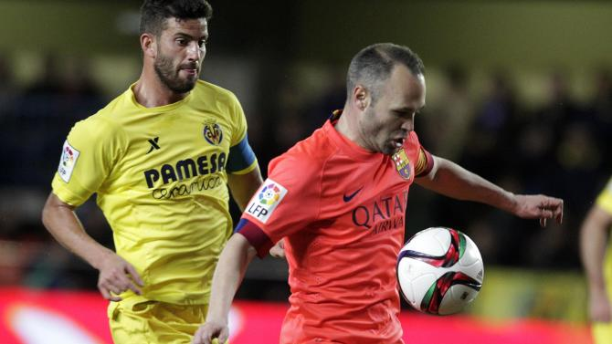 Barcelona's Iniesta controls the ball past Villarreal's Musacchio during their Spanish King's Cup semi-final second leg soccer match at the Madrigal stadium in Villarreal