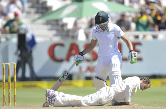 Australia's Nathan Lyon, takes a dive in front of South Africa's Faf du Plessis at the wicket on the third day of the third cricket test in Cape Town, South Africa, Monday, March 3, 2014. (AP