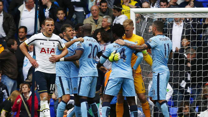 Football: Manchester City's Joe Hart and Wilfried Bony celebrate with team mates after the game as Tottenham's Harry Kane looks dejected