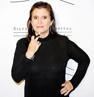 """Carrie Fisher on Star Wars: Episode VII Role: """"They're Sending a Trainer to My House So I Can Get in Really Good Shape"""""""