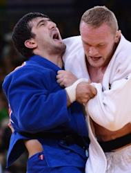 Germany's Dimitri Peters (white) competes with Russia's Tagir Khaibulaev (blue) in the men's -100kg judo semi-final at the London Olympics. The pair were watched by British Prime Minister David Cameron and Russian President Vladimir Putin
