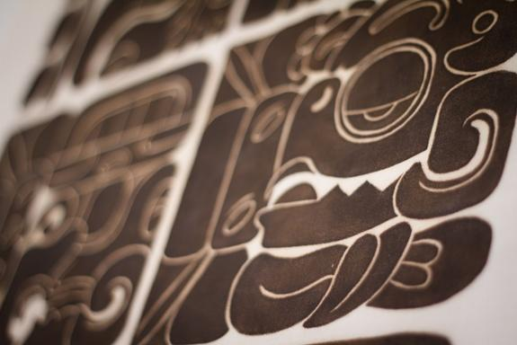 This silkscreen shows dates in the Maya Long Count Calendar and a sacred calendar called the Tzolk'in. The silkscreen is based on carvings found in Quirigua, Guatemala.