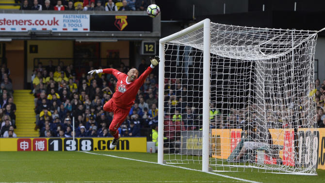 Watford's Heurelho Gomes attempts to make a save