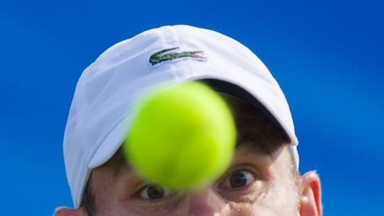 TOPSHOTS Andy Roddick Of The US Eyes The Ball As He Returns Against Jeremy Chardy Of France AFP/Getty Images