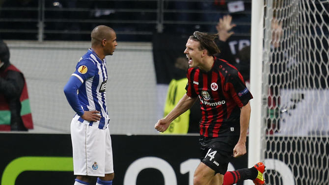 Frankfurt's Alexander Meier celebrates his side's third goal during a Europa League round of 32 second leg soccer match between Eintracht Frankfurt and FC Porto in Frankfurt, Germany, Thursday, Feb. 27, 2014