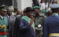Goodluck Jonathan, center, waves as he arrives for his inauguration ceremony at the main parade ground in Nigeria's capital of Abuja, Sunday, May 29, 2011. Jonathan was sworn in Sunday for a full four-year term as president of Nigeria and is now faced with the challenge of uniting a country that saw deadly postelection violence despite what observers called the fairest vote in over a decade.