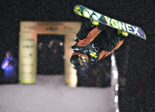 Antoine Truchon leaps to a third-place finish in during the snowboard big air final Friday, Jan. 17, 2014, in Quebec City. (AP Photo/The Canadian Press, Jacques Boissinot)