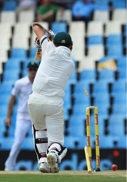 Australia's batsman Peter Siddle, is bowled by South Africa's bowler Dale Steyn, for 2 runs on the second day of their their cricket test match at Centurion Park in Pretoria, South Africa, Thu