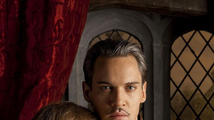 "Tamzin Merchant as Katherine Howard and Jonathan Rhys Meyers as Henry VIII in ""The Tudors."""