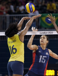 USA's Logan Tom (15) spikes the ball at Fernanda Rodrigues (16) during a women's volleyball gold medal match at the 2012 Summer Olympics Saturday, Aug. 11, 2012, in London. (AP Photo/Chris O'Meara)