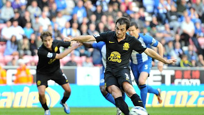 Leighton Baines rescued a point as Everton held on at Wigan