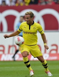 Dortmund's Mario Goetze, seen here in action during their German first division Bundesliga match vs Nuernberg, in Nuremberg, southern Germany, on September 1. Dortmund, who have won the German league title for the last two seasons, host Bayer Leverkusen on Saturday with German Chancellor Angela Merkel expected to be in the crowd